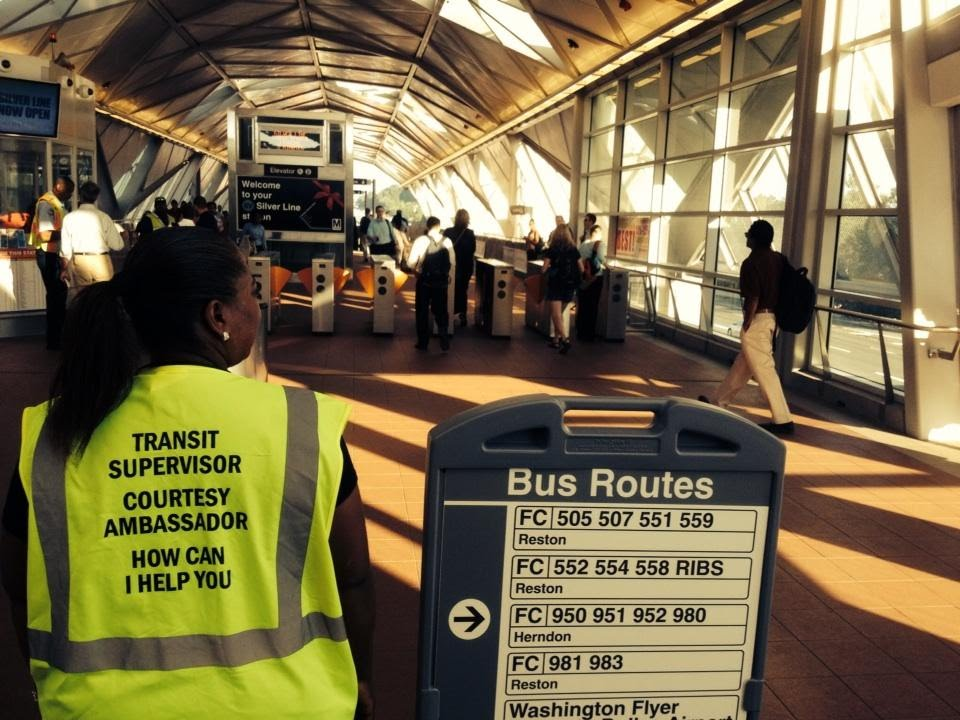 WMATA employees help direct commuters on the Silver Line. (WTOP/Kristi King)